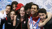 Kaetlyn Osmond, centre, and the rest of the Canadian figure skating team waits for Osmond's results in the women's team short program at the Iceberg Skating Palace during the 2014 Winter Olympics, Saturday, Feb. 8, 2014, in Sochi, Russia. (Darron Cummings/AP Photo)