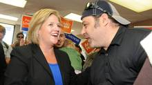 Ontario NDP leader Andrea Horwath greets supporters at NDP candidate Paul Loewenberg's campaign office in Sudbury, Ont., Oct. 4, 2011. (Gino Donato/The Canadian Press/Gino Donato/The Canadian Press)