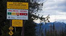 "A sign showing an avalanche hazard warning of ""considerable"" is seen at a parking lot where snowmobilers embark from near Mount Renshaw outside of McBride, B.C., on Saturday January 30, 2016. Five snowmobilers died Friday in a major avalanche in the Renshaw area east of McBride. (DARRYL DYCK/THE CANADIAN PRESS)"