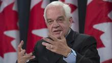 Immigration Minister John McCallum updates the media on the Syrian refugees arriving in Canada, during a news conference, Wednesday, February 3, 2016 in Ottawa. (Adrian Wyld/THE CANADIAN PRESS)