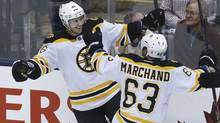 Boston Bruins forward David Krejci celebrates his overtime goal with teammate Brad Marchand in Game 4 against the Toronto Maple Leafs. (Moe Doiron/The Globe and Mail)