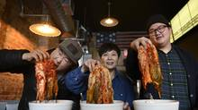Kim Han, centre, handed down her kimchi recipe to her sons Leemo, left, and Leeto, who now run the Toronto restaurant Oddseoul. (Fred Lum/The Globe and Mail)