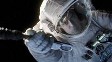 In the film Gravity, released Oct. 4, 2013, the audience is given time to ponder and experience being alone in space. (Courtesy of Warner Bros. Picture/AP)