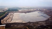 A tailings pond is pictured at the Syncrude oil sands facility near Fort McMurray, Alta., on July 10, 2012. (Jeff McIntosh/The Canadian Press)