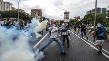 Demonstrators clash with the riot police during a protest against Venezuelan President Nicolas Maduro, in Caracas, on April 20, 2017. (JUAN BARRETO/AFP/Getty Images)