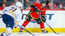 Calgary Flames defenseman Mark Giordano controls the puck against Buffalo Sabres during the first period at Scotiabank Saddledome. (Sergei Belski/USA Today Sports)