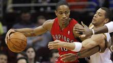 Toronto Raptors' DeMar DeRozan pushes to the key against Cleveland Cavaliers' Anthony Parker in the first quarter in Cleveland, March 13, 2012. (Amy Sancetta/The Associated Press/Amy Sancetta/The Associated Press)