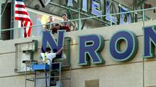 402709 01: Stadium employees remove letters from one of the Enron Field signs March 21, 2002 in Houston, TX. The Houston Astros paid $2.1 million to get back the naming rights to their stadium from collasped energy trader Enron. (James Nielsen/Getty Images/James Nielsen/Getty Images)