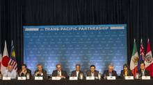Trans-Pacific Partnership ministers at a press conference to discuss progress in the negotiations in Maui, Hawaii, last Friday. Canada is at the centre of both major obstacles to a TPP deal that were cited by negotiators: the future of auto and dairy trade. (MARCO GARCIA/REUTERS)