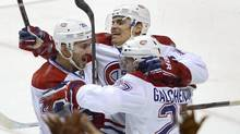 Montreal Canadiens' Rene Bourque (C) celebrates his game winning goal against Florida Panthers, with teammates Josh Gorges (L) and Alex Galchenyuk (R), during overtime of their NHL hockey game in Sunrise, Florida February 14, 2013. (RHONA WISE/REUTERS)