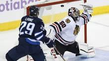 The Jets' Patrik Laine scores on Chicago Blackhawks goaltender Corey Crawford on Nov. 15. (John Woods/The Canadian Press)