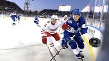 Toronto Maple Leafs centre William Nylander (29) and Detroit Red Wings right wing Gustav Nyquist (14) chases the puck along the corner boards during second period NHL Centennial Classic hockey action in Toronto on Sunday, January 1, 2017. (Frank Gunn/THE CANADIAN PRESS)
