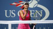 Peng Shuai of China celebrates a point against Belinda Bencic of Switzerland during their quarter-final match at the 2014 U.S. Open tennis tournament in New York, September 2, 2014. (ADAM HUNGER/REUTERS)