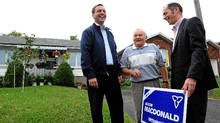 Progressive Conservative leader Tim Hudak, left, makes a campaign stop with PC candidate Jason MacDonald in Ottawa-South (Liberal Leader Dalton McGuinty's riding) on Sept. 8, 2011. (Sean Kilpatrick/Sean Kilpatrick/The Canadian Press)