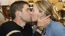 Canadian cross-country skier Beckie Scott is kissed by her husband Justin Wadsworth, left, in their hotel in Ramsau, Austria, after learning that her silver medal from the Salt Lake City Olympic games in the 5 kilometers competition was to be elevated to a gold after a decision by a court of arbitration for sport, on Thursday, Dec. 18, 2003. Scott originally won bronze but due to doping Olga Danilova (gold) and Larissa Lazutina (silver), both of Russia lost their medals. (AP Photo/Kerstin Joensson) (KERSTIN JOENSSON)