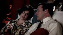 An undated handout image of Neve Campbell, who appeared in Party of Five in the 1990s, and Jon Hamm in the Mad Men 7th season premiere (AMC)