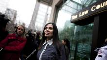 Eileen Mohan, mother of Surrey Six murder victim Christopher Mohan, walks out of the B.C. Supreme Court in Vancouver, British Columbia, Thursday, November 28, 2013. Quang Vinh Thang (Michael) Le, one of three suspects on trial for murder in the 2007 Surrey Six case, has pleaded guilty to conspiracy to commit murder in the death of Corey Lal. (Rafal Gerszak for The Globe and Mail)