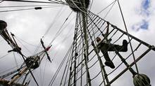A Russian crew member tends to the rigging on one of the ships as the crew prepares for the Tall Ships race. (Ian Hodgson/REUTERS)