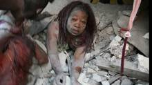 A Haitian woman is covered in rubble in Port-au-Prince. (DANIEL MOREL)
