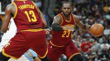 Cleveland Cavaliers forward LeBron James, right, looks to pass the ball during the first half of an NBA basketball game Wednesday, March 22, 2017. (David Zalubowski/AP)