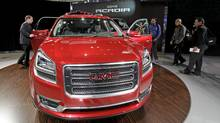 GMC introduces the 2013 Acadia vehicle during the media preview of the Chicago Auto Show at McCormick Place in Chicago on Wednesday, Feb. 8, 2012. (Nam Y. Huh/Nam Y. Huh/AP)