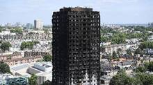 The remains of Grenfell Tower are seen from a neighbouring tower block in London, England, on June 16, 2017. (Carl Court/Getty Images)