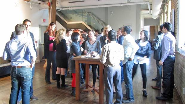 Small business owners and guests mingle at The Spoke club in Toronto
