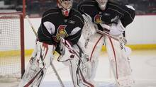Ottawa Senators goalie Craig Anderson (left) stands in the goal crease with Ben Bishop during pre-season training camp in Ottawa, Ont., Thursday January 17, 2013. THE CANADIAN PRESS/Adrian Wyld (Adrian Wyld/THE CANADIAN PRESS)