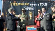 The FIFA cup is unveiled Wednesday morning in Mississauga as part of an 86-country world tour leading up to the tournament in South Africa. From left: FIFA's Bryan Chenault Canadian Soccer association Dominic Maestracci, Coca-Cola official Nikolaos Koumettis, musician K'Naan, Coca-Cola official Kevin Warren, and Immigration Minister Jason Kenney.
