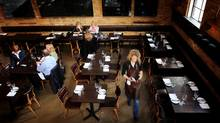 While Buca's high-ceilinged dining room is largely unadorned, a warm glow suffuses all the pretty people. (Kevin Van Paassen/Kevin Van Paassen/THE GLOBE AND)