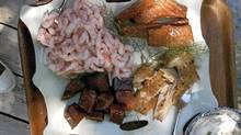 Small hand-peeled B.C. shrimp, hot smoked salmon, smoked mackerel, maple-cured salmon candy, and creme fraiche mixed with dill and horseradish, in Sechelt. (Ian Brown/The Globe and Mail)