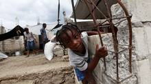 A young boy plays in a temporary camp for Jacmel residents displaced by Haiti's earthquake. (Deborah Baic/Deborah Baic/The Globe and Mail)