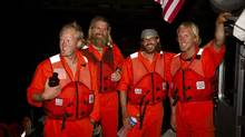 From left, Adam Kreek, Jordan Hanssen, Patrick Fleming, Markus Pukonen arriving safely to the United States Coast Guard base in San Juan, Puerto Rico. (CWF/Erinn J Hale Photography)
