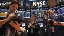 Traders work the floor at the New York Stock Exchange in New York, Dec. 26, 2012. (EDUARDO MUNOZ/REUTERS)