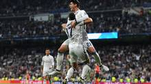 Real Madrid's Lucas Vazquez, front, celebrates after scoring in a Group F match against Legia Warszawa on Oct. 18, 2016. (Denis Doyle/Getty Images)