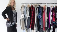 Linda Fittler, vice-president of apparel and product development at Wal-Mart Canada, poses near a rack of the company's new clothing line in Toronto, Ont. on Monday, June 16, 2014. (Darren Calabrese)