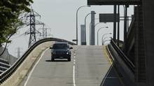 Traffic exits the eastbound Gardiner Expressway at the Yonge St. exit in Toronto on June 29, 2015. (Fred Lum/The Globe and Mail)