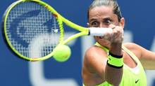 Italy's Roberta Vinci hits a return against Germany's Angelique Kerber during their quarter-final match at the U.S. Open on Sept. 6, 2016. (JEWEL SAMAD/AFP/Getty Images)