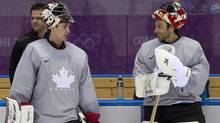Team Canada goalies Carey Price and Roberto Luongo talk during practice at the Sochi Winter Olympics Tuesday February 11, 2014 in Sochi, Russia. (The Canadian Press)