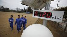 Students walk near a geiger counter at Omika Elementary School, located about 21 km from the tsunami-crippled Fukushima Daiichi nuclear power plant in Japan on March 8, 2012. (Toru Hanai/REUTERS/Toru Hanai/REUTERS)