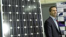 Ontario Premier Dalton McGuinty, beside a solar panel at Joe NG Engineering Ltd. in Hamilton on Nov. 9, 2010. (Nathan Denette/The Canadian Press)