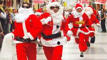 People dressed as Santa Claus participate in a race through a downtown pedestrian street in Lima. The event was organized by several downtown stores to promote Christmas shopping. (ENRIQUE CASTRO-MENDIVIL/ENRIQUE CASTRO-MENDIVIL/REUTERS)