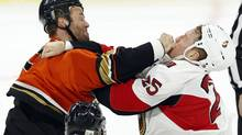 The Ottawa Senators' Chris Neil, right, fights with the Anaheim Ducks' Clayton Stoner in Ottawa on Saturday. (FRED CHARTRAND/THE CANADIAN PRESS)