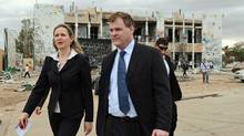 Foreign Affairs Minister John Baird and Canadian Ambassador to Libya Sandra McCardell visit one of Moammar Gadhafi's fortified compounds in Tripoli on OCt. 11, 2011. (Sean Kilpatrick/The Canadian Press)