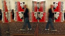 A man walks past Michael Ignatieff signs at the Liberal Party's election-night rally in Toronto on May 2, 2011. (Peter Power/Peter Power/The Globe and Mail)