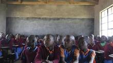 Grade 6 students cram into desks at Pimbiniet Primary School in Kenya's Narok South district. (Josh O'Kane/The Globe and Mail)