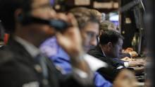 Traderswork on the floor of the New York Stock Exchange, August 22, 2012. (BRENDAN MCDERMID/REUTERS)