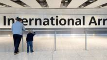 A father and son wait for a relative at Terminal 5's arrivals area at Heathrow Airport, London, Wednesday, Nov. 30, 2011. (AP)
