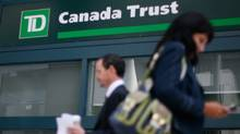 People walk past a Toronto Dominion Bank branch in Ottawa August 27, 2009. (CHRIS WATTIE)