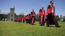 Graduating PhD and Masters students head towards Convocation Hall at the University of Toronto on Friday, June 15, 2012. (Matthew Sherwood For The Globe and Mail)